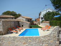 Looking from the parking across the pool & garden to the houses in Kovaci, Istria