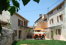 house and barn facing each other across the courtyard in Kovaci, Istria