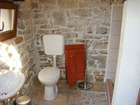 Wet room with enormous shower & washing machine in part of restored old outbuilding in Kovaci, Istria